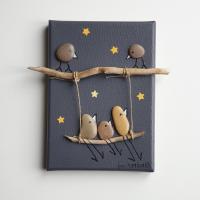 Tableau galets oiseaux balançoire