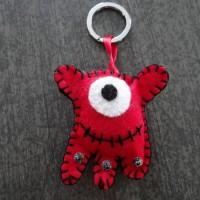 Porte clés monstre rouge