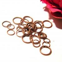 lot de 500 anneaux (12 gr) cuivre rouge - taille mixte de 4 à 10 mm -  AN10