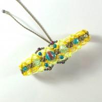 Bracelet en macramé et perles tons jaune/vert