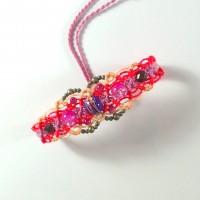 Bracelet en macramé et perles tons rose/orange