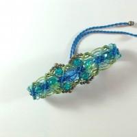 Bracelet en macramé et perles tons bleu/vert