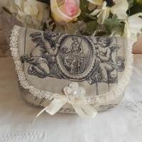 pochette   tissu dentelle motif angelots pour maquillage ou bijou